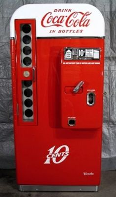 Antique Coke Machine 1950 's - I wasn't born until the 60s but these were still around then. You pulled a bottle out - no cans of soda back then.