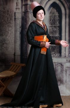 a Burgundian dress in wool satin, with brocade cuffs and collar