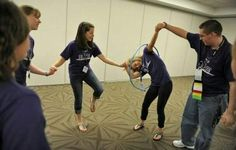 Students race to pass a hula hoop around each other while holding hands as they play cooperative games while participating in the Building Leaders And Strong Tomorrows Youth Group Games, Team Games, Youth Activities, Family Games, Activity Games, Fun Games, Games For Kids, Youth Groups, Team Building Activities