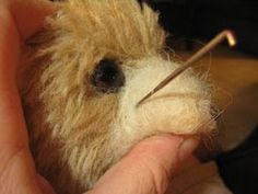 How to felt a muzzle with pulled threads for hair as finishing touch.