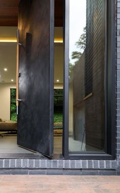 Read about our newest steel door installation in Atlanta. This unique and contemporary door shows the range of custom styles available at Scardino Doors. Modern Entrance Door, Modern Exterior Doors, Entrance Lighting, Modern Front Door, Front Door Entrance, House Entrance, Doorway, Front Doors, Main Door Design