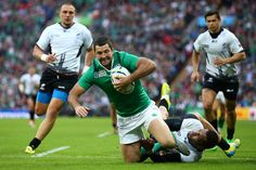 Rugby World Cup 2015 - Match Centre - Match 19eland v Romania - Group D: Rugby World Cup 2015 LONDON, ENGLAND - SEPTEMBER 27: Rob Kearney of Ireland evades as tackle to score their fifth try during the 2015 Rugby World Cup Pool D match between Ireland and Romania at Wembley Stadium on September 27, 2015 in London, United Kingdom. (Photo by Paul Gilham/Getty Images)