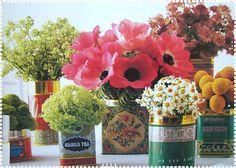 Flower centerpieces using tea tins