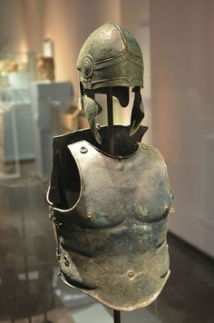 Chalcidian style Helmet and Muscle Cuirass of a Greek warrior. Found in Apulia, modern day south-east Italy. 340 to 330 BC. Greek History, Ancient History, Ancient Greek Clothing, Greek Artifacts, Greek Helmet, Roman Armor, Ancient Armor, Roman Warriors, Greek Warrior