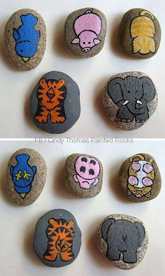 A menagerie of two-sided critters painted on rocks and stones.