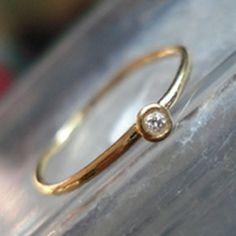 the most teeny tiny delicate diamond ring.  find @ www.wishdesignshop.com
