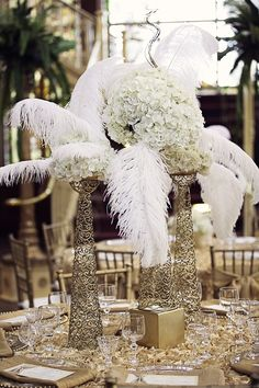 Nothing is off limits when creating your centerpieces. This couple incorporated feathers.