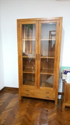 This two unit teak wood display cabinet with glass doors in the upper section. Feature with a 2 doors and 2 drawers for storage.  Dimensions: L110XD40XH200cm