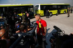 Clint Dempsey Photos Photos - Clint Dempsey of the United States is interviewed by media after arriving at Sao Paulo International Airport on June 9, 2014 in Sao Paulo, Brazil. - USA Team Arrives in Sao Paulo