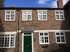 The front of the house, wooden Venetian blinds with tape. Shrewsbury. http://blindsshrewsbury.co.uk