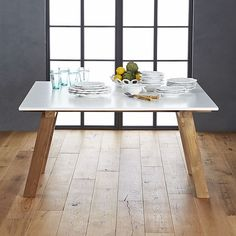 Riviera Square White Top Dining Table This Is Clean Glossy With Natural Wood Legs