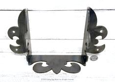 We make all kinds of custom steel joist hangers. These steel wood connectors are great when you want to have them not only hold together your rafters or fl. Modern Fireplace Decor, Entrance Hall Decor, Welded Metal Projects, Decorative Shelf Brackets, Ranch Style Homes, Wood And Metal, Metal Work, Wrought Iron, Building Products