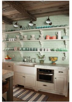 Sea glass green subway tile backsplash and open shelves. So pretty!