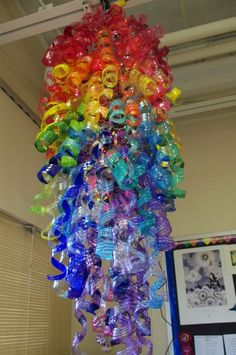 How to make turning plastic bottles into colorful flower petal art