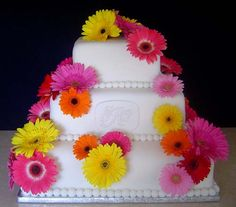 Three iter square fondant wedding cake decorated with pink, yellow, orange and red gerbera daisies. Perfect for a spring wedding. From princessd6601 www.flickr.com            ........   #wedding #cake #birthday
