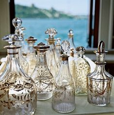 I love decanters -- we have several old ones at home.  Now I want to collect them and arrange them like so.