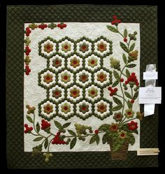 """""""Perseverence"""" was made by Merry Ann Rothe and quilted by Donna Scofield.  The pattern is from """"Quilts from Grandmother's Garden"""" by Jaynette Huff."""