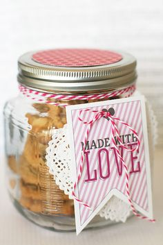 """Let them know those cookies were  made with love.  SUPPLIES: wide mouth jar... white paper heart doilies... twine or string... patterned paper... 3"""" circle punch... small hole punch... tags... and of course homemade cookies!"""