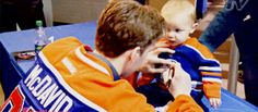Connor McDavid signing a baby. The baby is just like, whut?