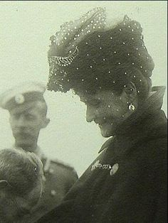 Empress Alexandra.  Of the hundreds of pictures I have seen of her, this is the ONLY one in which she is smiling.l