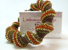 Earth Mother Beadwoven Cellini Spiral Bangle by littlestonedesign, $59.00