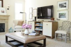 love the decorating details: frames around TV, accent chair beside console, floor lamp by chair...