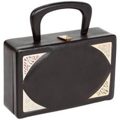 29cc74289ff7 ... on - Prestige  Destination Purse  in black pebbled leather with top  handle and featuring four metal plaques bearing the names of  destination   cities
