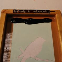 Simple instructions for using a paper stencil for screen printing.