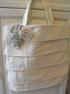 I have got to try this @Erin B B Kleckneror @Emily Schoenfeld Schoenfeld Broussard -DIY ruffle purse. All you do is get a plain canvas bag (3 pack at walmart for $5) and sew some ruffles onto it. Add flowers for a touch of cuteness.