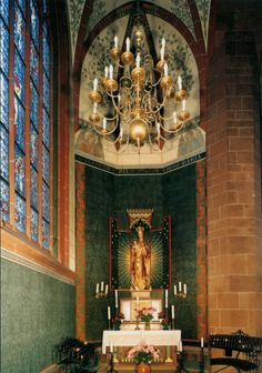 "O clemens, o pia, o dulcis Virgo Maria The interior of the Lady chapel in Worms cathedral, Germany. Above the altar the last line from the hymn Salve Regina is written: ""O clement, O loving, O sweet..."