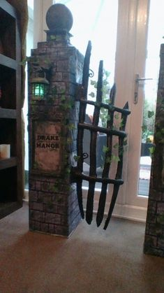 Halloween Forum member Drake Manor Entrance Columns (I'm back!)-gate made from pool noodles and black tape! Genius.