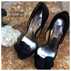 Badgley Mischka Black Satin Pumps Badgley Mischka Black Satin Randall Pumps/Heels with peep toe and bow. Please see pics for details. SOLD OUT! Size: 7M. These are great pumps!!! Condition: Excellent. Includes dust bag. Badgley Mischka Shoes Heels