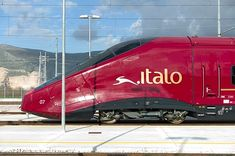"Italian bullet train ""Italo"" with Ferrari red"