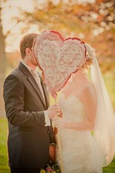 Valentine Day Wedding Picture of Bride and Groom Behind Heart