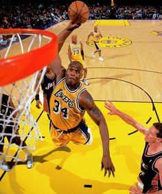 Lakers center Shaquille O'Neal throws down a monsterous dunk during a 2000 game against the Jazz.