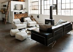 Warehouse Living | Leather, Firewood, Polished Concrete, Old Ladder, White, Industrial Windows, Living room