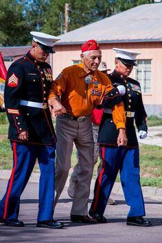 Two Navajo Marines helped Navajo Code Talker Roy Hawthorne, USMC, WWII during a parade to honor the Navajo Code Talkers in Arizona. August 2013.