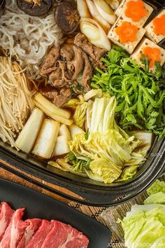 Sukiyaki (すき焼き) is a popular Japanese hot pot dish which is often cooked and served at the table, similar like Shabu Shabu (しゃぶしゃぶ).