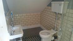 Compact loft conversion ensuite with beautiful tiling detail. Loft Conversion Ensuite, Tiling, Compact, Toilet, Bathtub, Bathroom, Detail, Beautiful, Standing Bath
