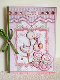 New Baby Girl, card topper with 3d step by step decoupage. A coordinating insert is also available. See multilink below.    Features cute stork with baby bundle in a frame and baby bootees.    Sentiment tags, include one blank. The others read,  Congratulations It's a Girl  Welcome Little One