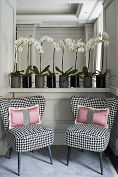 Black & white nook with orchids and pink pillows making great use of an awkward little corner - love those chairs! #home #decor