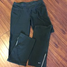NIKE FIT DRY SWEATS  Nike Fit Dry Sweats... Color; Green... Drawstring waist nice band...reflectors on ankles.. On back waistZip pocket..excellent condition..Size M Nike Pants Track Pants & Joggers