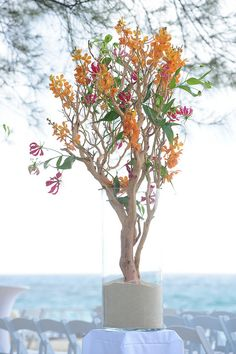 Colorful, tropical orchid centerpiece by Parfait Weddings, Grand Cayman