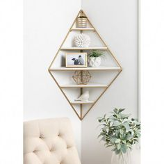 Love that this Mid Century Modern Corner Wall Shelf by Modern Rustic Interiors could be used in any room in my house! Love that this Mid Century Modern Corner Wall Shelf by Modern Rustic Interiors could be used in any room in my house! Geometric Shelves, Honeycomb Shelves, Hexagon Shelves, Geometric Decor, Diy Wand, Corner Wall Shelves, Corner Wall Decor, Gold Wall Decor, Living Room Corner Decor