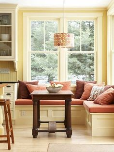 window seat built into the corner instead of a table & chairs, simple box benches finished with molding to create panels.