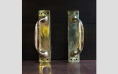 Brass, small pulls. £95 for pair