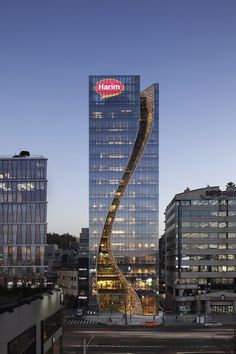 harim's new headquarters designed by beck group includes a sparkling slit across its façade