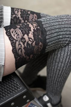 Soft and slouchable, these over the knee socks also stay up well on their own, thanks to their thick rib knit! A perfect mix of marled yarn and wide floral lace, they're delightfully cozy while keeping things fancy.