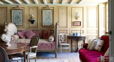 In the breakfast room, the sofa is by Georges Jacob, and the table, medallion chairs, and daybed are all 18th century.