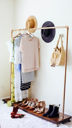 Small closet solution: Pipe clothing rack DIY. cute idea for my tiny house.